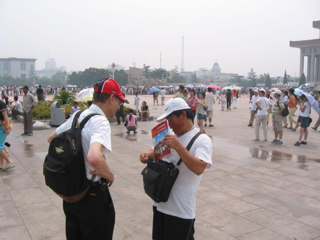 Trying to sell Norty a tourist guide in Beijing